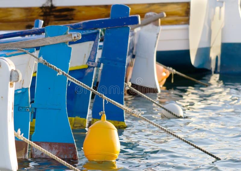 Σημαντήρας και βάρκες στοκ φωτογραφία
