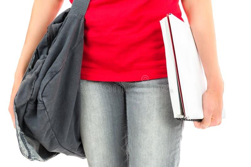 Σημειωματάρια εκμετάλλευσης σπουδαστών στο χέρι της στοκ φωτογραφία με δικαίωμα ελεύθερης χρήσης