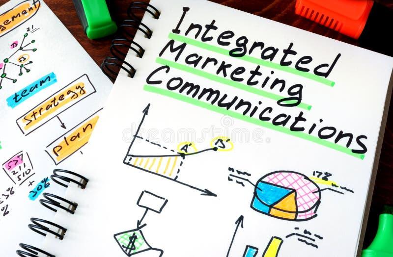 Σημειωματάριο με ολοκληρωμένες τις σημάδι επικοινωνίες IMC μάρκετινγκ στοκ φωτογραφία με δικαίωμα ελεύθερης χρήσης