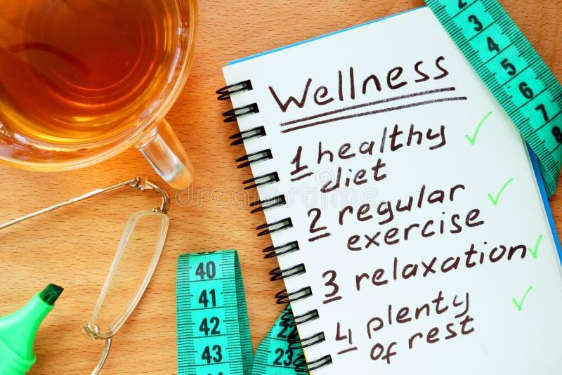 Σημειωματάριο με την έννοια Wellness στοκ εικόνα