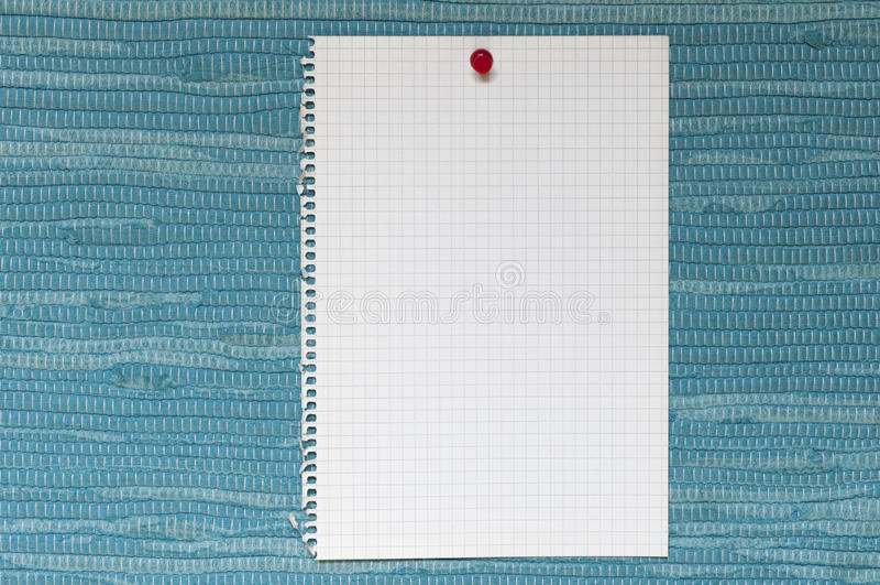 Σημειωματάριο μπροστά από το μπλε υφαμένο ύφασμα στοκ φωτογραφία