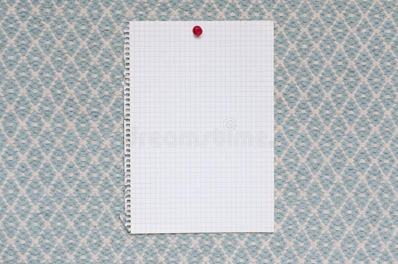 Σημειωματάριο μπροστά από το μπλε υφαμένο ύφασμα στοκ εικόνες