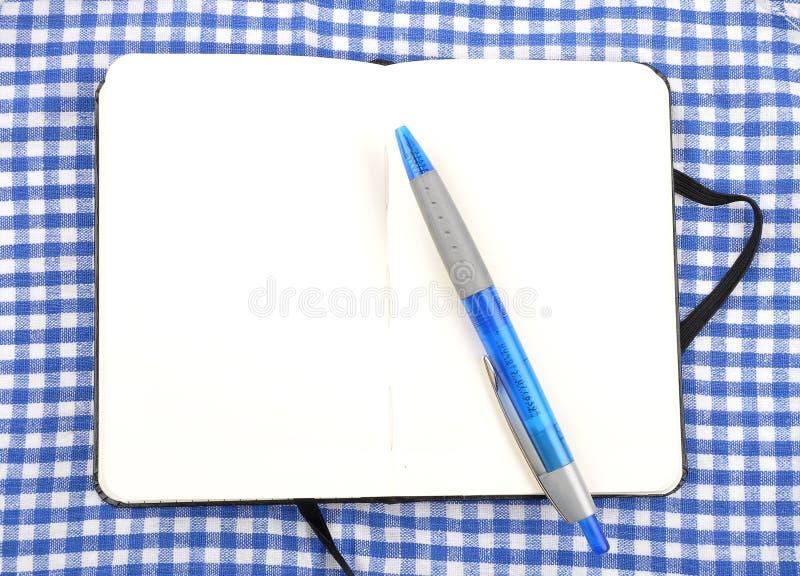 Σημειωματάριο στο ύφασμα στοκ φωτογραφίες