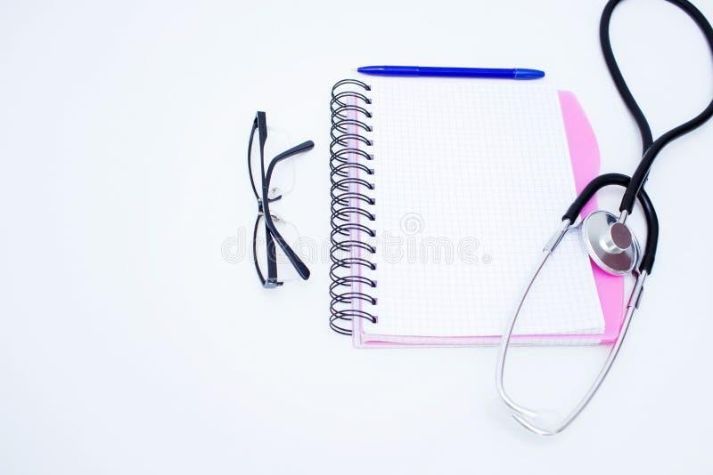 Σημειωματάριο του γιατρού στο άσπρο υπόβαθρο Σύσταση και ανασκόπηση στοκ εικόνες με δικαίωμα ελεύθερης χρήσης