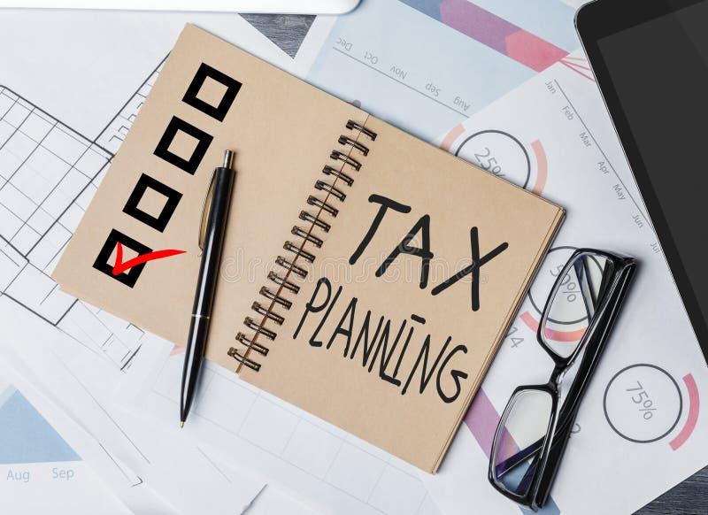 Σημειωματάριο φορολογικού προγραμματισμού στοκ φωτογραφία