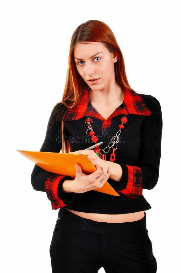Σημειώσεις γραψίματος επιχειρησιακών γυναικών στοκ φωτογραφίες με δικαίωμα ελεύθερης χρήσης