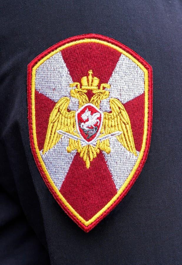 Σιρίτι στις στολές μανικιών του ανώτερου υπαλλήλου της εθνικής φρουράς στοκ εικόνα με δικαίωμα ελεύθερης χρήσης