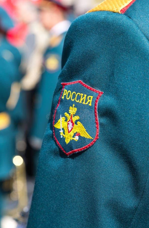 Σιρίτι στις στολές μανικιών του στρατιώτη στοκ φωτογραφία με δικαίωμα ελεύθερης χρήσης