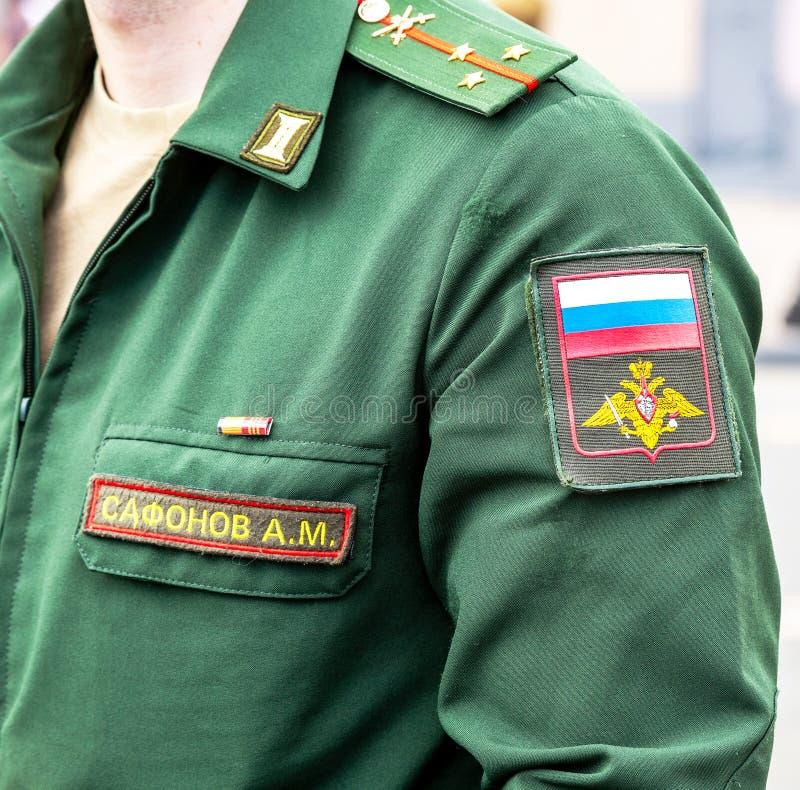 Σιρίτι στις στρατιωτικές στολές μανικιών στοκ εικόνες