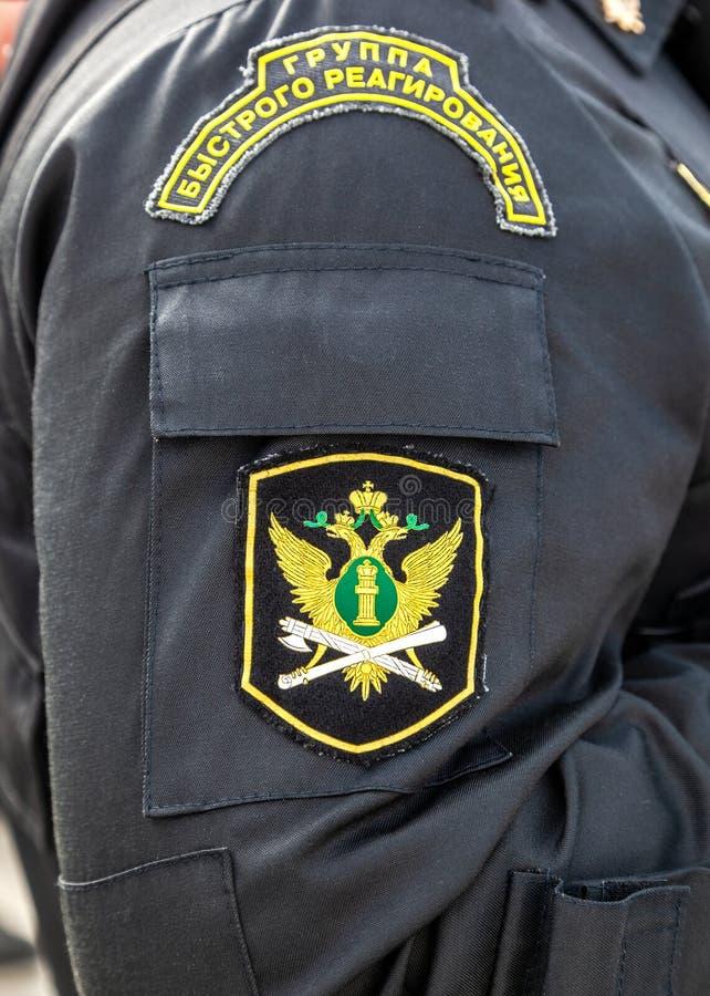 Σιρίτι στον ανώτερο υπάλληλο στολών μανικιών των ρωσικών ειδικών FO στοκ εικόνες