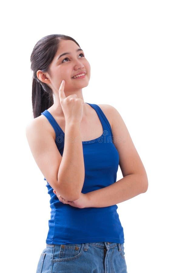 Σκέψη γυναικών χαμόγελου ασιατική νέα στοκ φωτογραφία με δικαίωμα ελεύθερης χρήσης