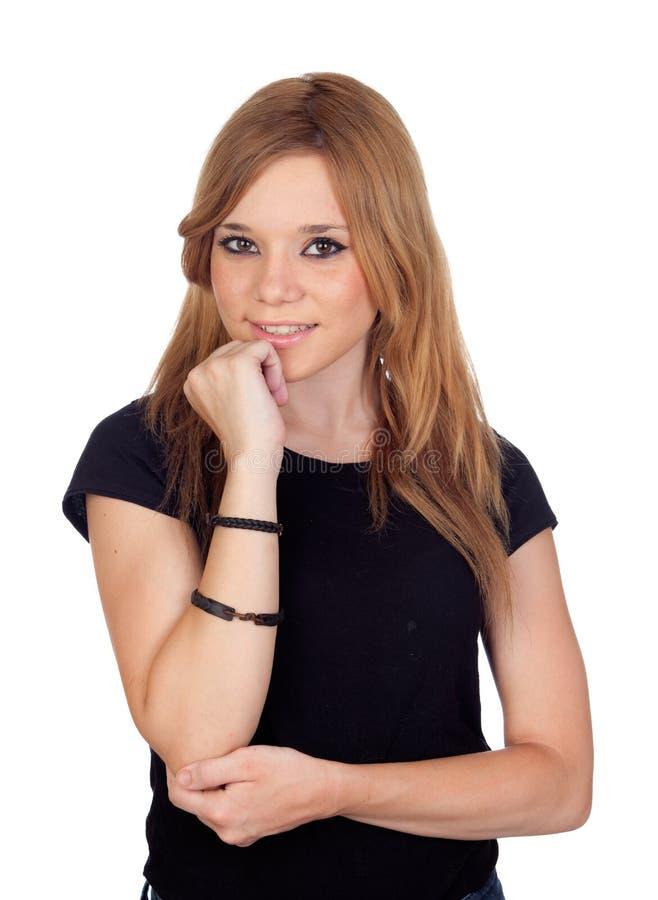 Σκεπτική ξανθή γυναίκα με το μαύρο πουκάμισο στοκ εικόνα