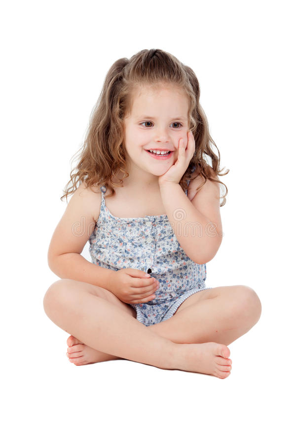 Σκεπτικό μικρό κορίτσι με τη συνεδρίαση τριάχρονων παιδιών στο πάτωμα στοκ φωτογραφίες