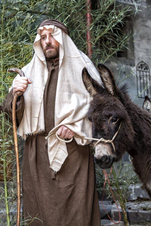 Σκηνή της ζωής του Ιησού Η πτήση στην Αίγυπτο Joseph και ένας γάιδαρος στοκ εικόνα