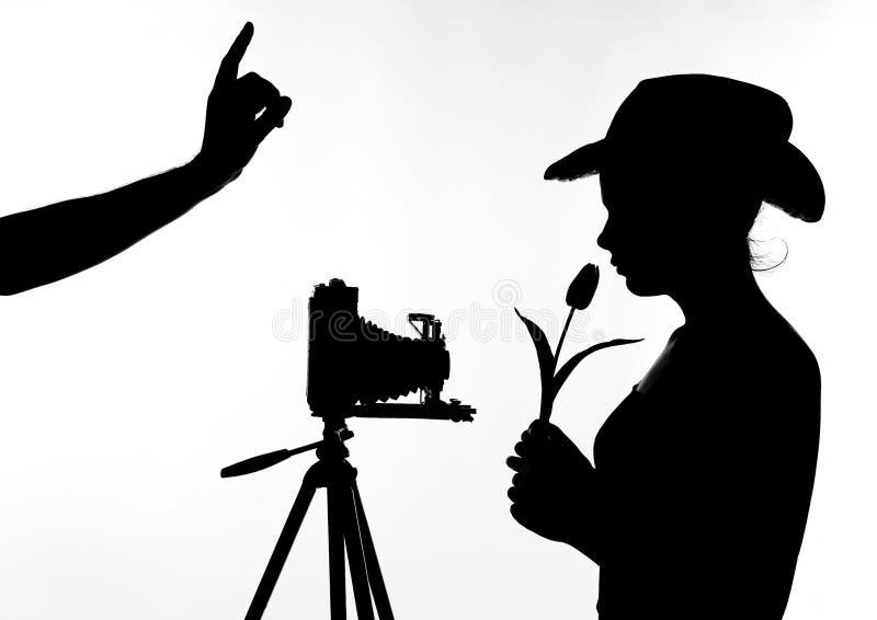 Σκιά κοριτσιών λουλουδιών φωτογράφων στοκ εικόνες