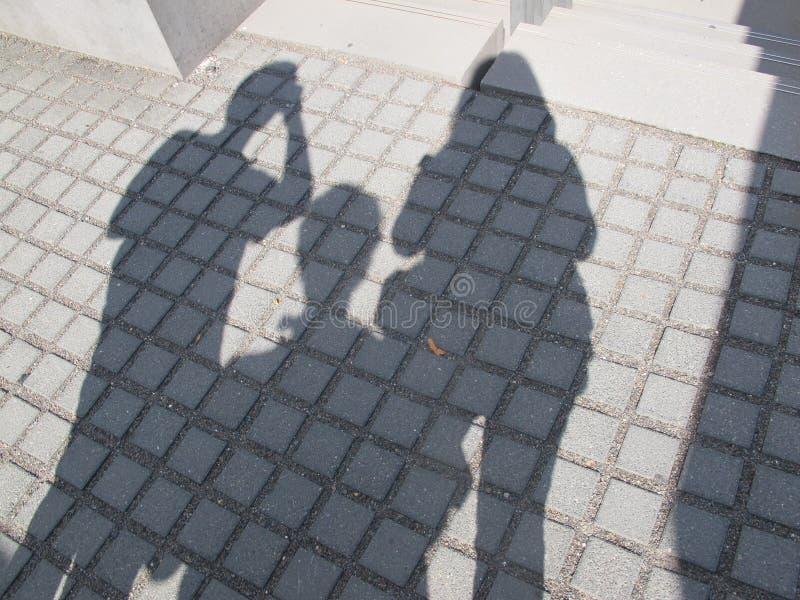 Σκιά τριών ανθρώπων στοκ φωτογραφίες
