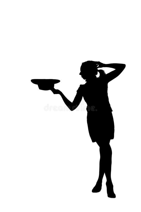Σκιαγραφία γυναικών που βγάζει ένα καπέλο στοκ εικόνες