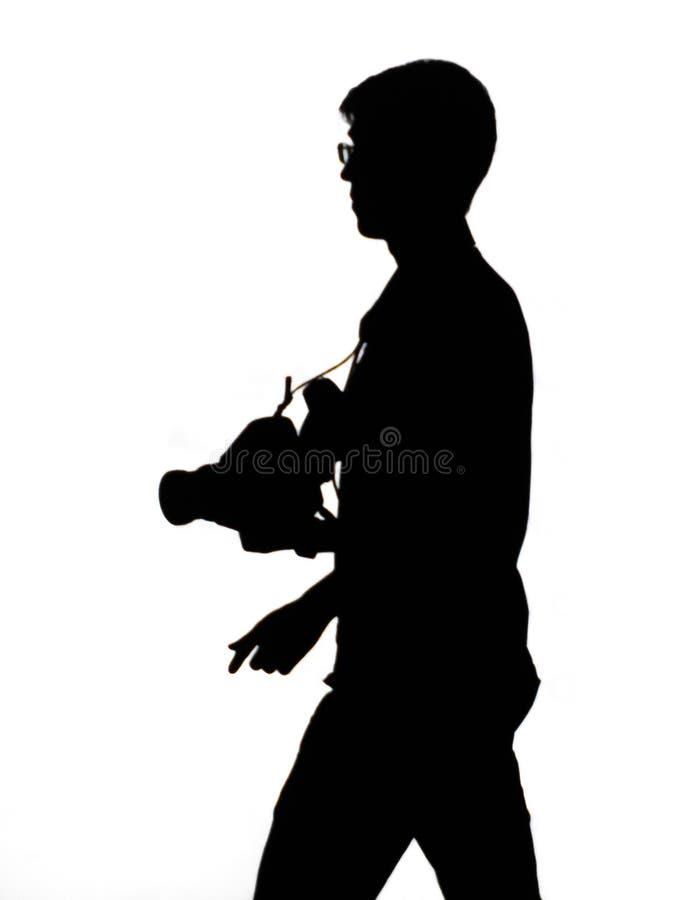 Σκιαγραφία ενός φωτογράφου σε ένα άσπρο υπόβαθρο στοκ φωτογραφία με δικαίωμα ελεύθερης χρήσης