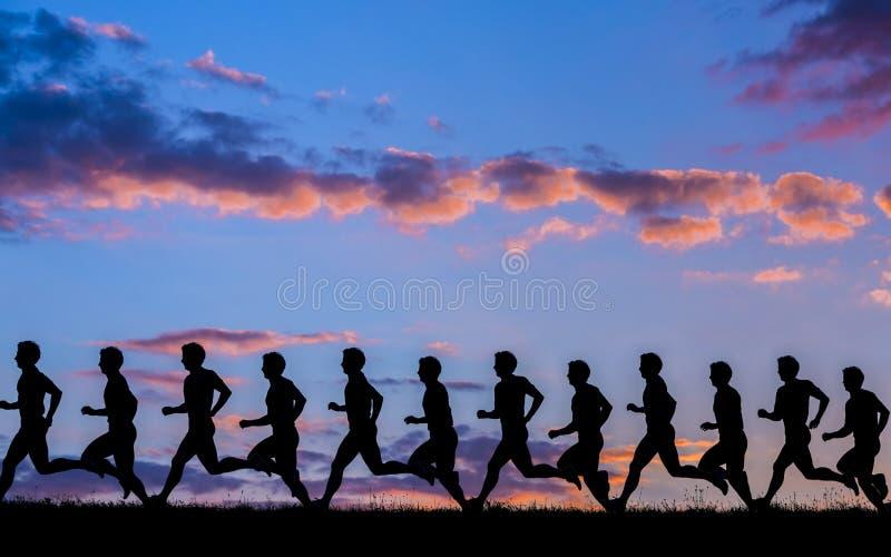 Σκιαγραφία ενός jogger στην ανατολή στοκ φωτογραφία