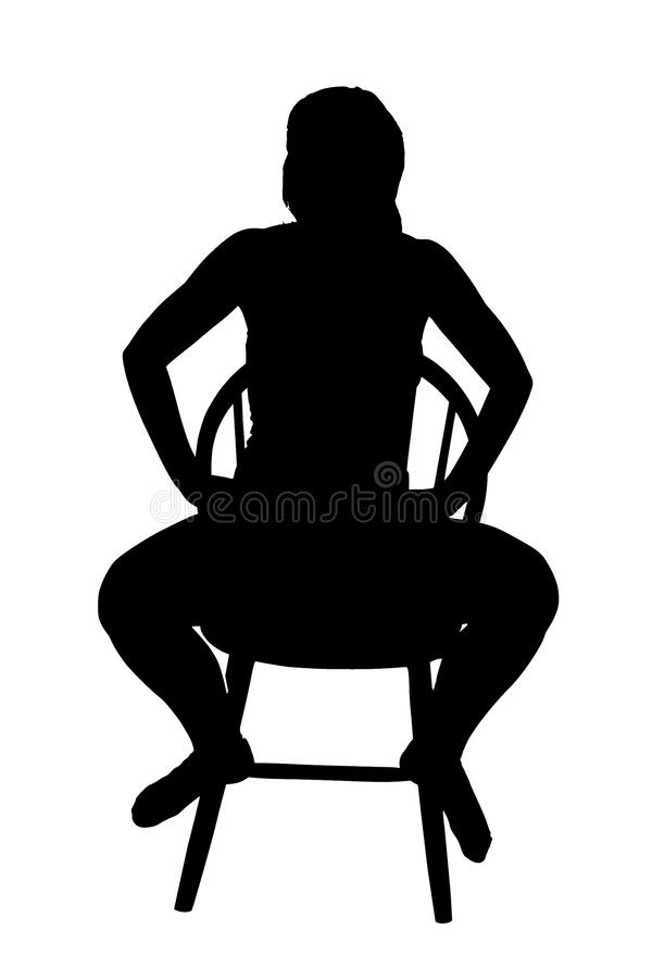 Σκιαγραφία μιας συνεδρίασης γυναικών σε μια καρέκλα στοκ φωτογραφίες