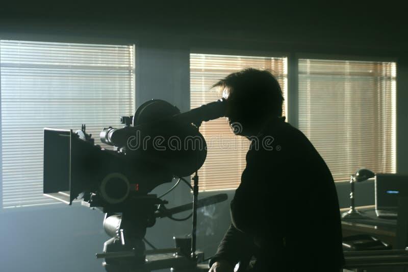 σκιαγραφία σκοταδιού καμεραμάν φωτογραφικών μηχανών στοκ φωτογραφία