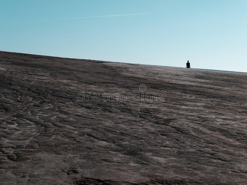Σκιαγραφία στους τομείς λάσπης στοκ φωτογραφίες με δικαίωμα ελεύθερης χρήσης