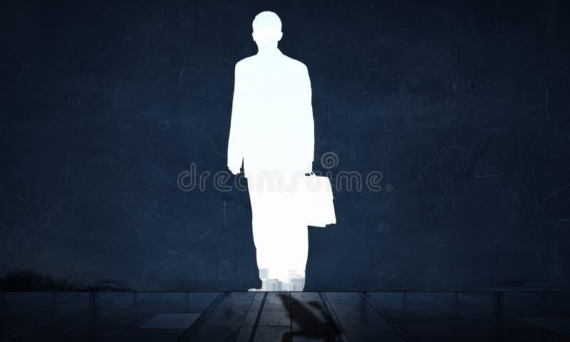 Σκιαγραφία του επιχειρηματία στον τοίχο Μικτά μέσα στοκ εικόνες
