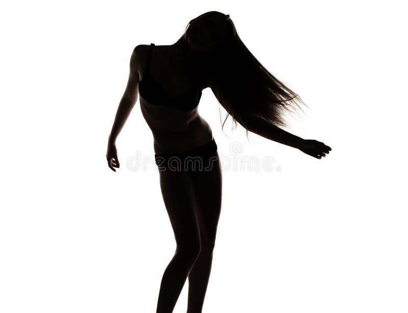 Σκιαγραφία του νέου χορεύοντας κοριτσιού στοκ εικόνες