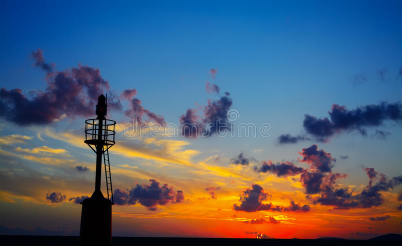 Σκιαγραφία φάρων στο ηλιοβασίλεμα σε Alghero στοκ φωτογραφία με δικαίωμα ελεύθερης χρήσης