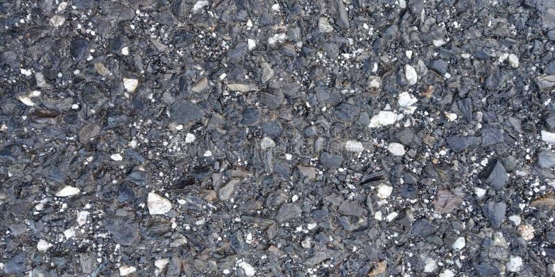 Σκοτεινή σύσταση πατωμάτων με τις πέτρες ξηρό πάτωμα στοκ φωτογραφίες
