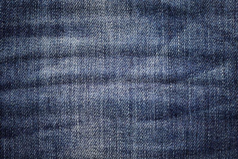 Σκοτεινό υπόβαθρο τζιν Κλασική σύσταση τζιν Επιφάνεια του ιματισμού μόδας στοκ εικόνα με δικαίωμα ελεύθερης χρήσης