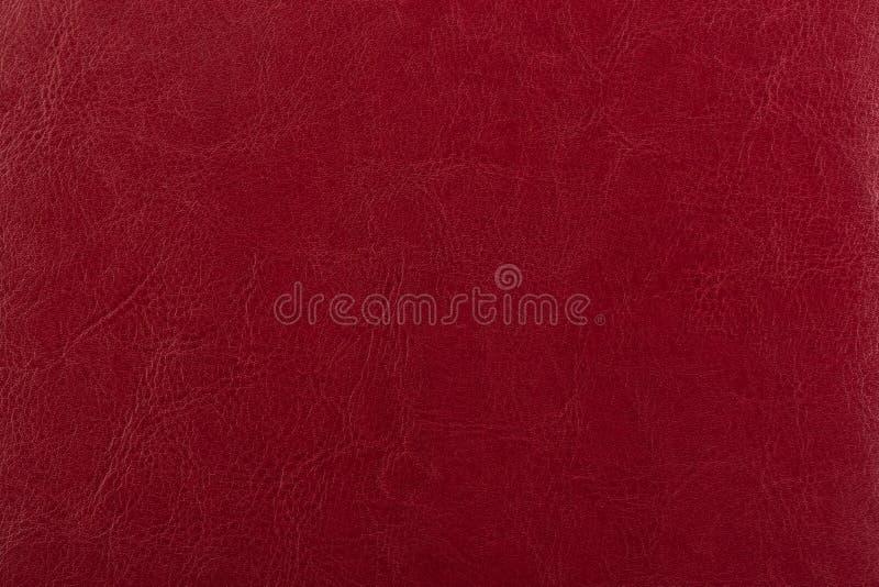 Σκούρο κόκκινο επιφάνεια δέρματος ως υπόβαθρο, σύσταση δέρματος δέρμα στοκ φωτογραφίες