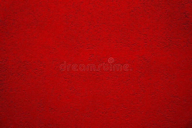 Σκούρο κόκκινο υπόβαθρο τοίχων Τοίχος ασβεστοκονιάματος στόκων σιταριού από μια χονδροειδή εξωτερική πρόσοψη σπιτιών ως κενό αγρο στοκ φωτογραφίες
