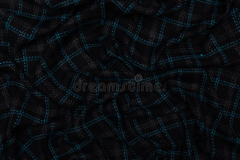 Σκούρο μπλε ελεγχμένο ύφασμα με το υφαντικό υπόβαθρο σύστασης στοκ εικόνες