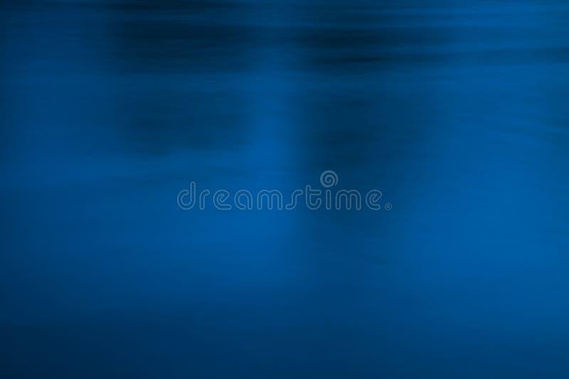 Σκούρο μπλε και μαύρο εννοιολογικό αφηρημένο υπόβαθρο στοκ εικόνες
