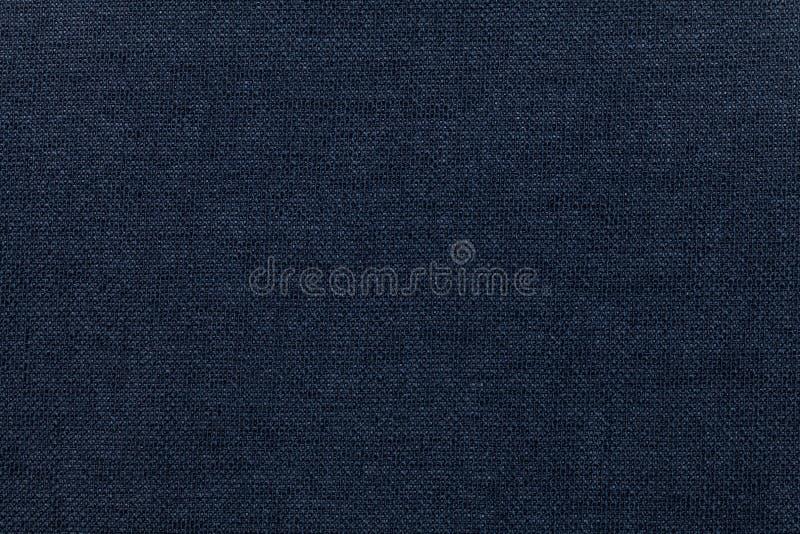 Σκούρο μπλε υπόβαθρο από ένα υφαντικό υλικό Ύφασμα με τη φυσική σύσταση backfill στοκ εικόνες με δικαίωμα ελεύθερης χρήσης