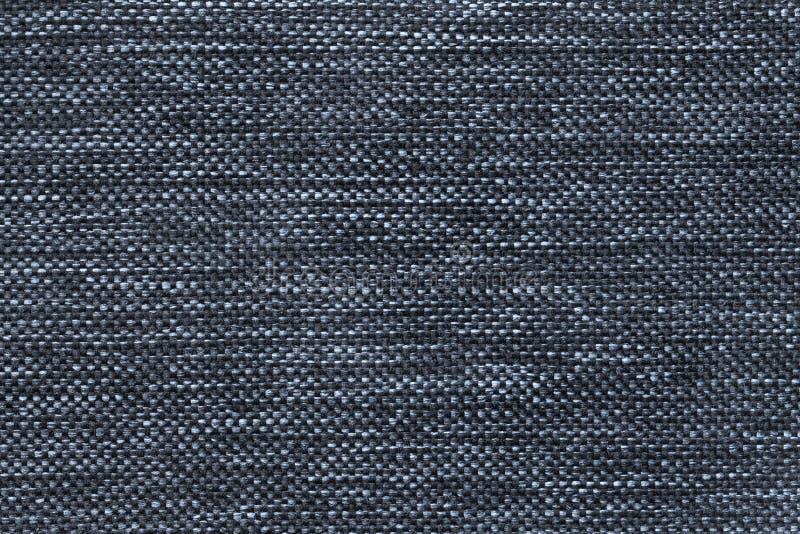 Σκούρο μπλε υπόβαθρο του πυκνού υφαμένου τοποθετώντας σε σάκκο υφάσματος, κινηματογράφηση σε πρώτο πλάνο Δομή της υφαντικής μακρο στοκ εικόνες