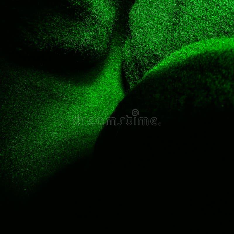 Σκούρο πράσινο τραχύ υπόβαθρο υφάσματος στοκ εικόνες