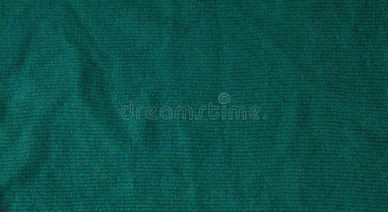 Σκούρο πράσινο υπόβαθρο από ένα υφαντικό υλικό Ύφασμα με τη φυσική σύσταση Σκηνικό υφασμάτων στοκ φωτογραφίες