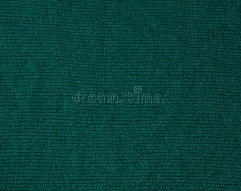 Σκούρο πράσινο υπόβαθρο από ένα υφαντικό υλικό Ύφασμα με τη φυσική σύσταση Σκηνικό υφασμάτων στοκ εικόνες