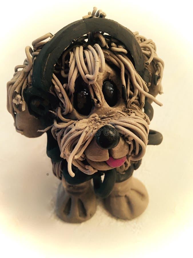 Σκυλί με τα ακουστικά και iPawd στοκ εικόνες