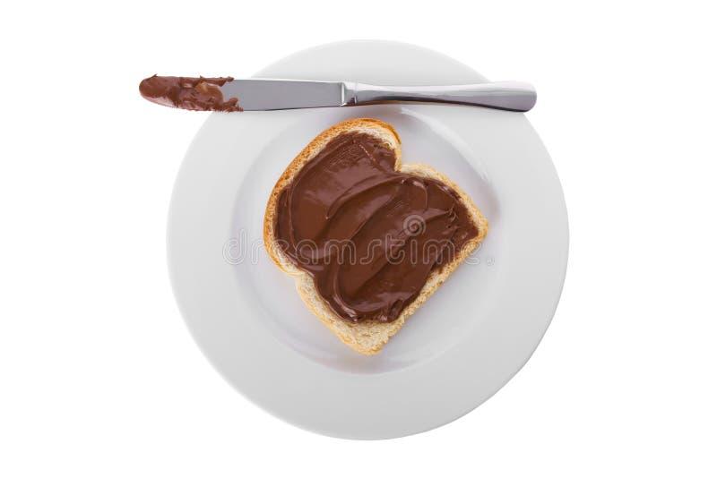 σοκολάτα ψωμιού πέρα από τη φέτα που διαδίδεται στοκ εικόνα με δικαίωμα ελεύθερης χρήσης