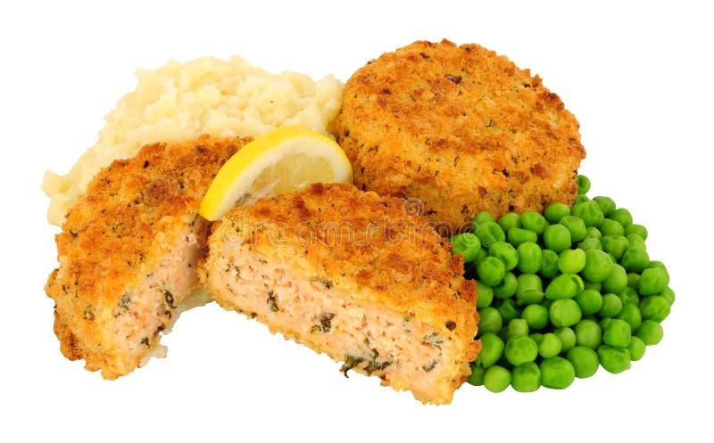 Σολομός Fishcake και πολτοποίηση γεύμα πατατών στοκ εικόνα με δικαίωμα ελεύθερης χρήσης