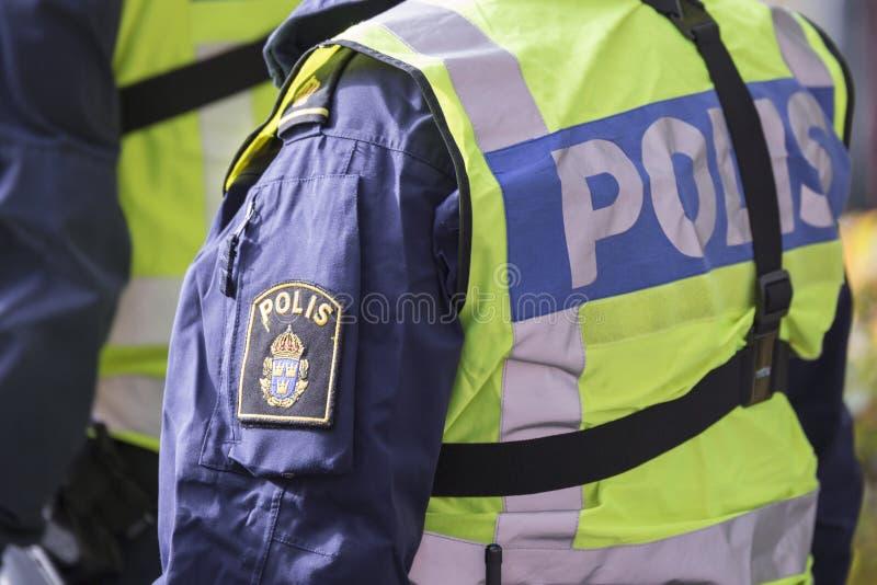 Σουηδικός αστυνομικός με την αντανακλαστική φανέλλα στοκ εικόνες