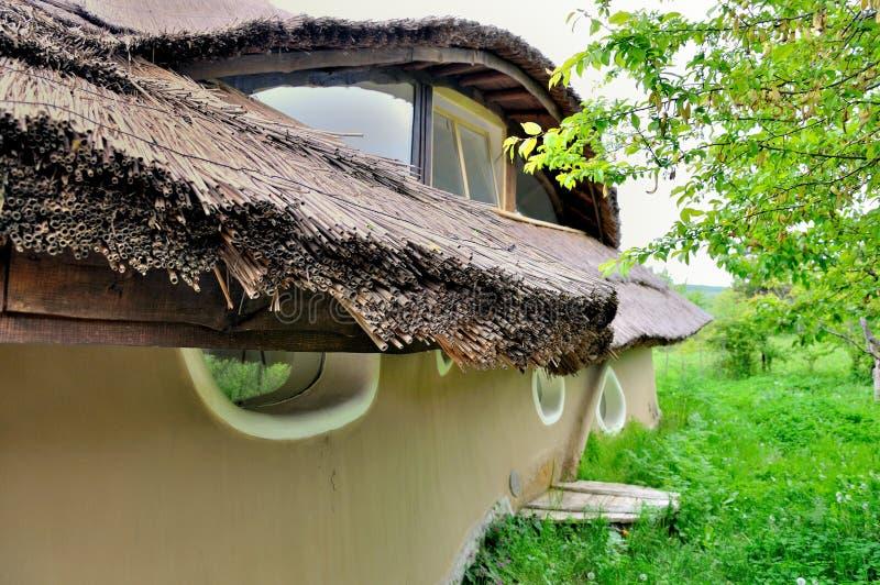 σπίτι αργίλου πλίθας thatch στοκ εικόνες