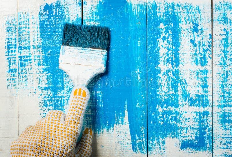 σπίτι ζωγραφικής χεριών στοκ εικόνα