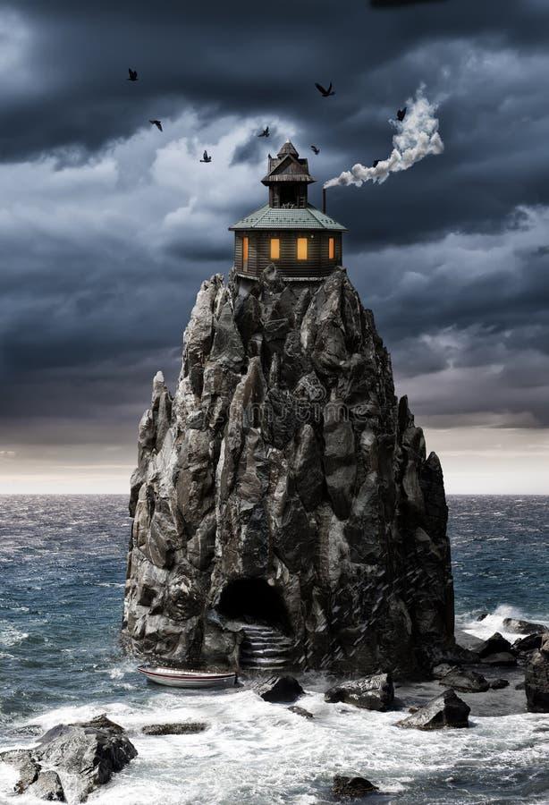 Σπίτι φαντασίας σε ένα νησί βράχου στη θάλασσα στοκ εικόνα