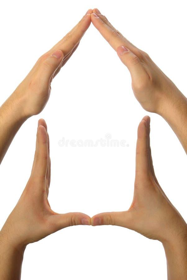 σπίτι χεριών που γίνεται στοκ εικόνα