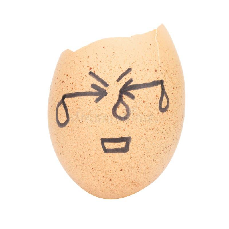 σπασμένη αυγό έννοια ατόμων προσώπου λυπημένη που απομονώνεται στο άσπρο υπόβαθρο στοκ εικόνα με δικαίωμα ελεύθερης χρήσης