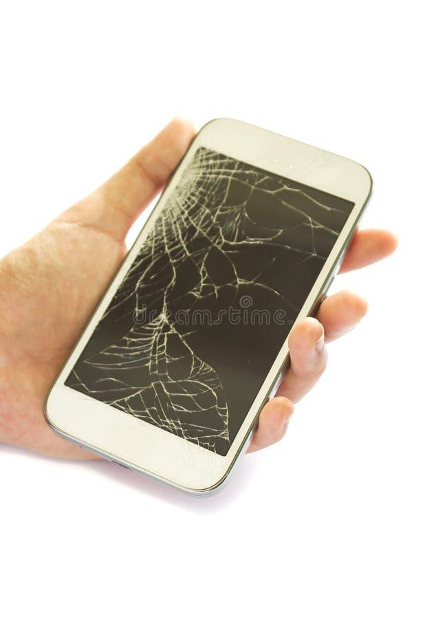 Σπασμένη οθόνη αφής χεριών γυναίκας εκμετάλλευση του άσπρου έξυπνου τηλεφώνου στοκ εικόνα με δικαίωμα ελεύθερης χρήσης